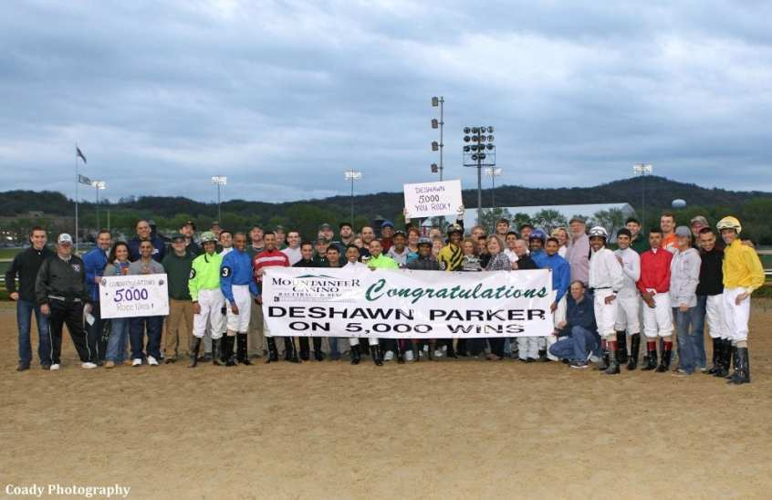 DeShawn Parker, along with family and the Mountaineer Park jockey colony, celebrate his 5,000th career win