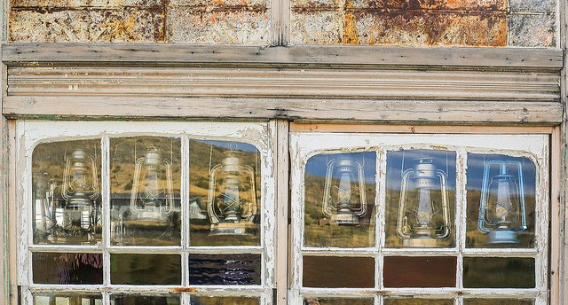 lanterns in window of old building