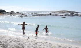 Playing in the waves in Camps Bay