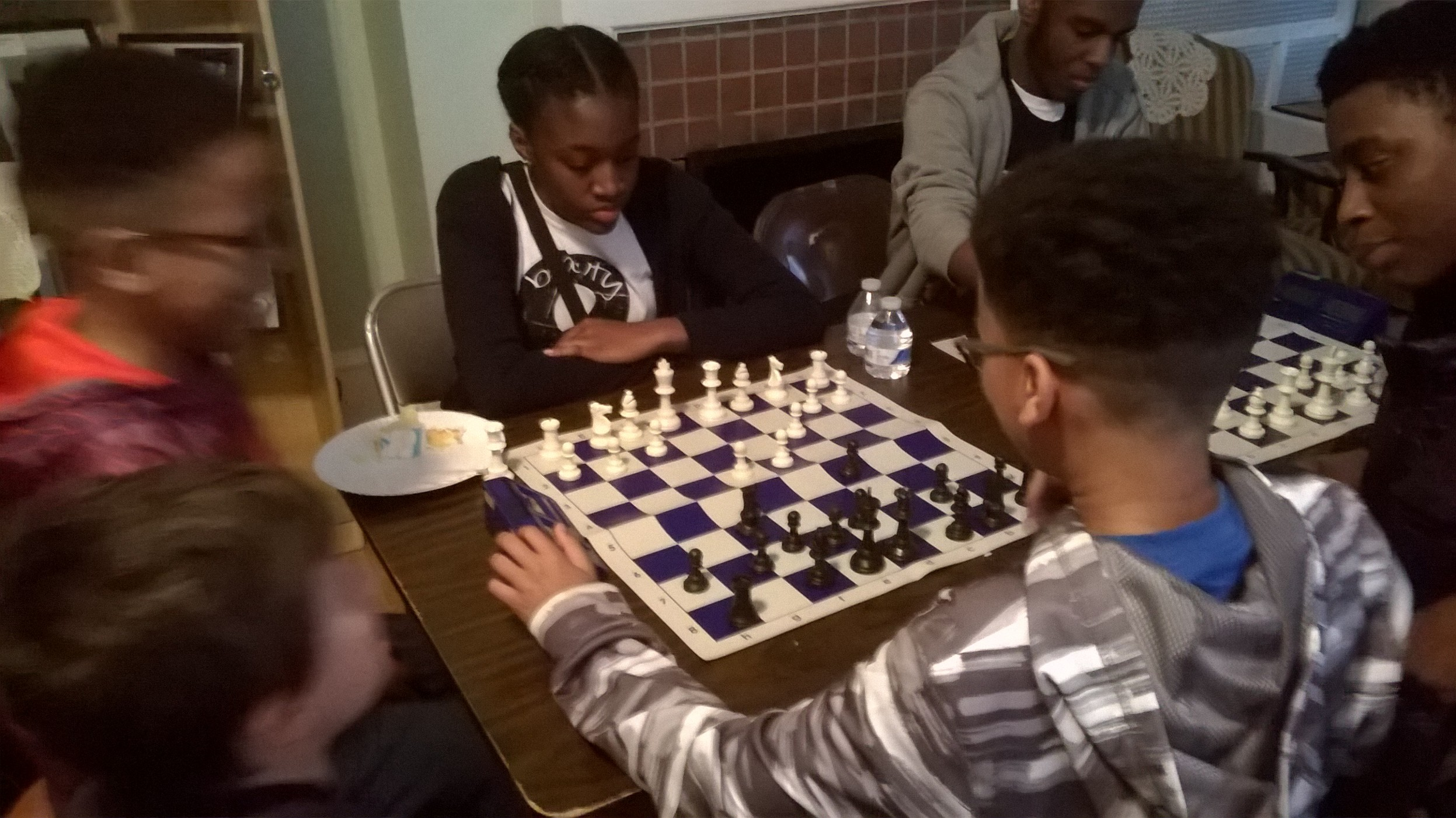 A Paul Robeson Chess Club member ponders a move.