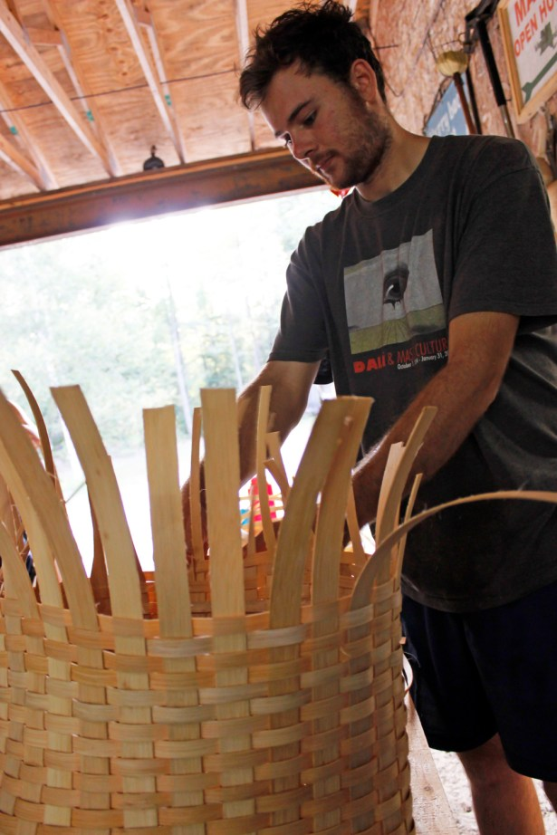 Andrew works away on his basket.