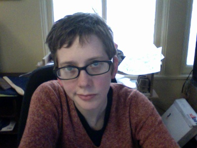 Webcam photograph of Colleen Coover judging the world.