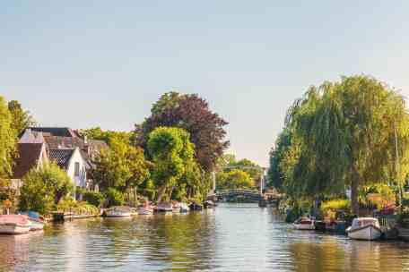 Historic houses alongside the Dutch river Vecht in Vreeland