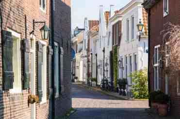 Streetscene of narrow street in old town of Naarden, North Holland, Netherlands