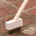 Wire brush for cleaning paving joints