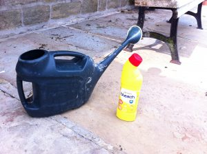 Equipment needed for patio cleaning using bleach an an old watering can