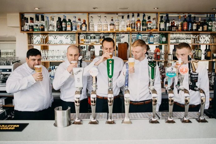 castle dargan bar with groom and groomsmen