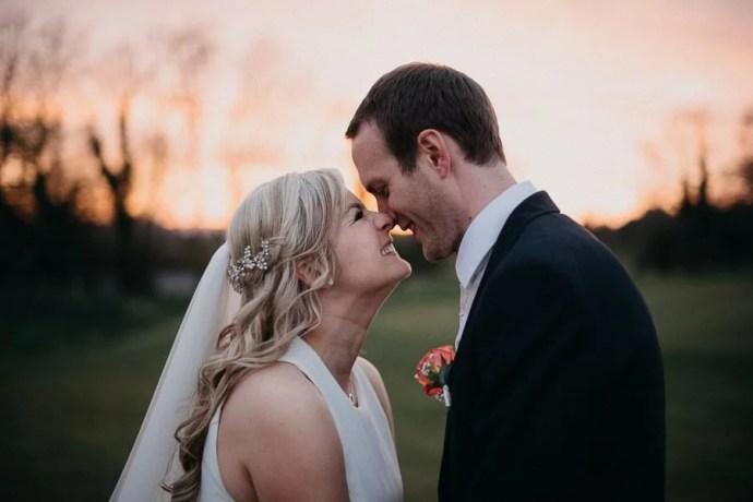 sunset wedding portrait in castle dargan golf field