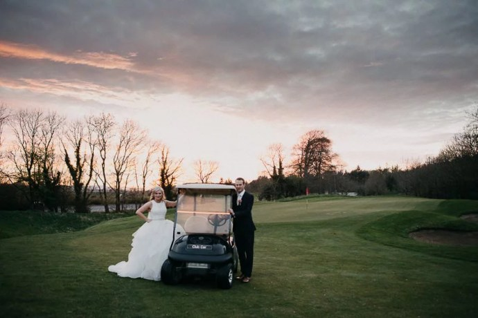sunset wedding portrait in castle dargan golf field