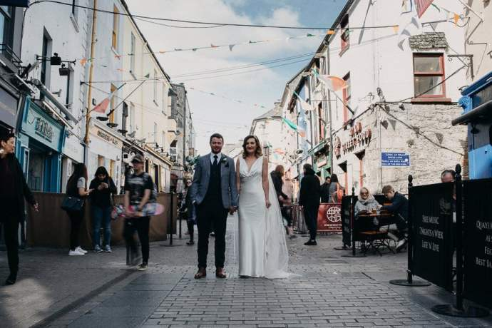 bride and groom in city center of Galway