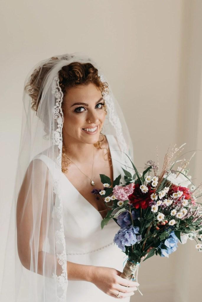 bride with flowers at castle dargan wedding venue, Sligo, Ireland
