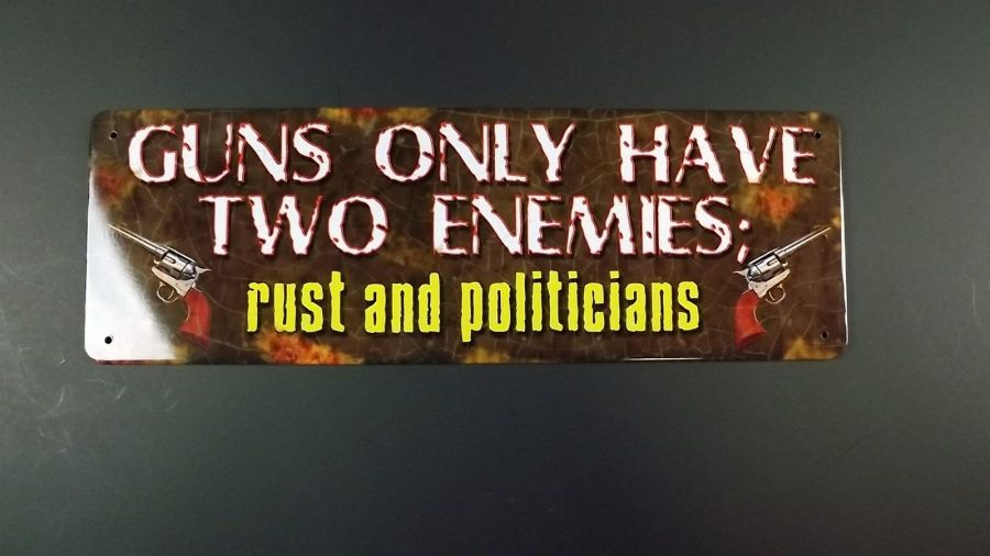 """GUNS ONLY HAVE TWO ENEMIES-rust and politicians"" METAL SIGN 11"" X 3.5"" NEW 1"