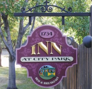 hand-crafted inn at city park sign