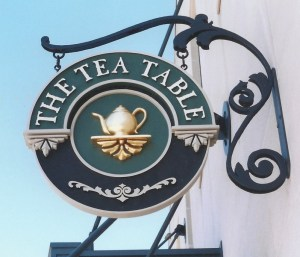 hand-crafted carved gold leaf tea table sign