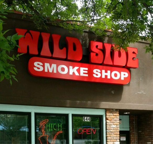 featured business wild side smoke shop sign