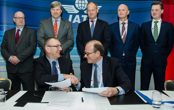Ferry van der Ent, director of special programs, Air Cargo Netherlands (seated, left) seals the deal with Rafael Schvartzman, regional VP Europe, IATA - watched by (L to R) Rupert Batstone (VP business support, Swissport), Marcel de Nooijer (executive VP, KLM Cargo), Jonas van Stekelenburg (director cargo, Amsterdam Airport Schiphol), Sebastiaan Scholte (CEO, Jan de Rijk Logistics) and Rogier Spoel (policy advisor, airfreight, EVO - Dutch Shippers' Council)