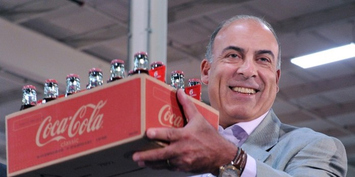 AXP101-October 5, 2010--DUNWOODY,GA-COCA-COLA -- The Coca-Cola Company Chairman and CEO Muhtar Kent accepts the first case of Coca-Cola produced by the new Coca-Cola Refreshments, Inc. at a special Town Hall for employees 10/5. HO Photo--MichaelPugh