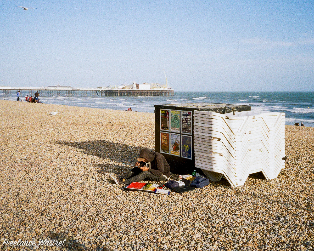 Artist on the beach, Brighton