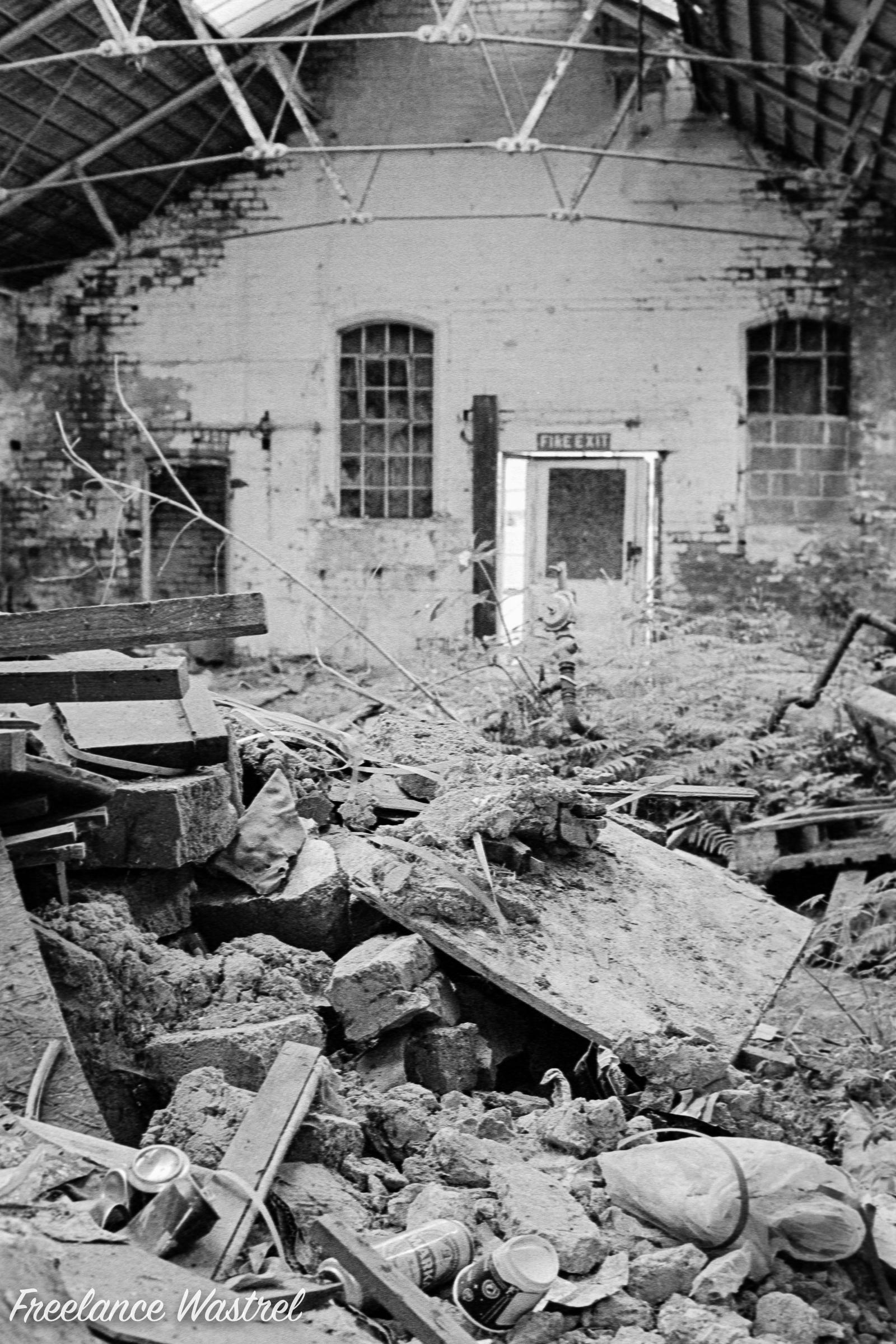 Through a broken window, Dame Flogan Street
