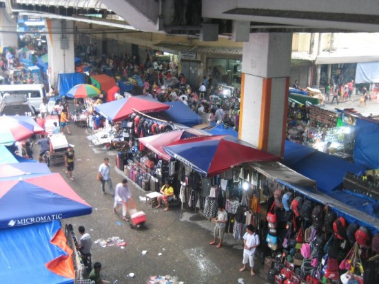 An outdoor market beneath a subway station in Manila, the capital of the Philippines. Photo by Sonia Paul.