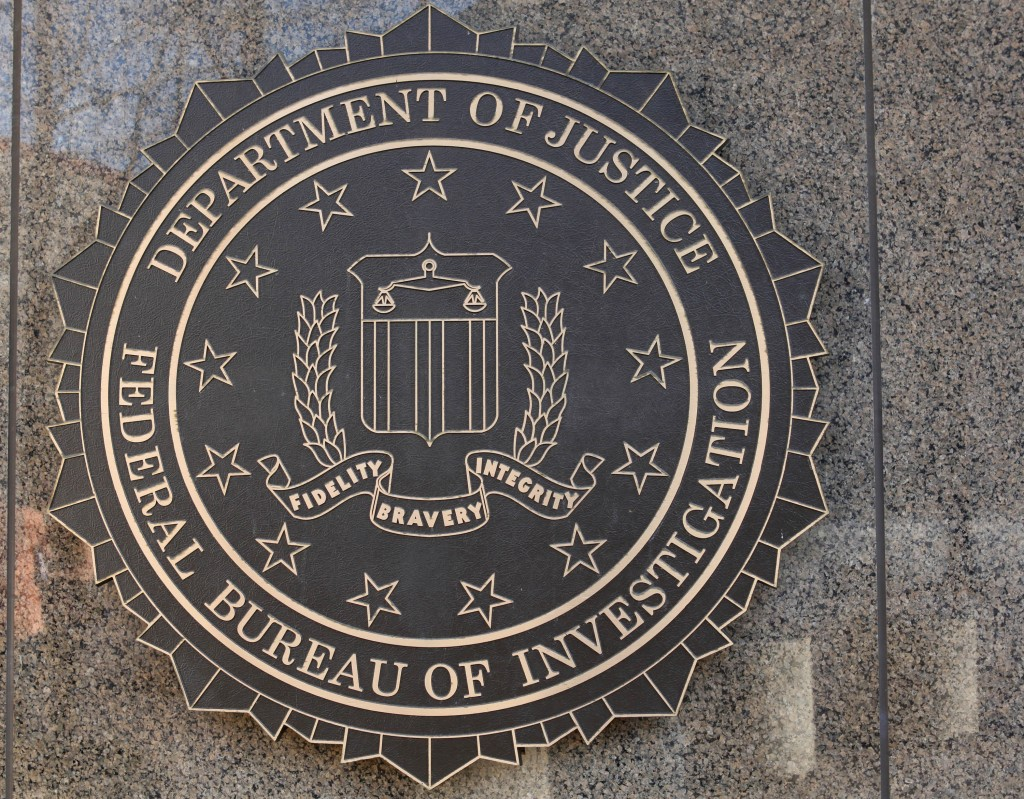 The J. Edgar Hoover Federal Bureau of Investigation (FBI) building crest is seen in Washington, D.C., U.S., on March 18, 2011. Photo by Rich Clement/Bloomberg