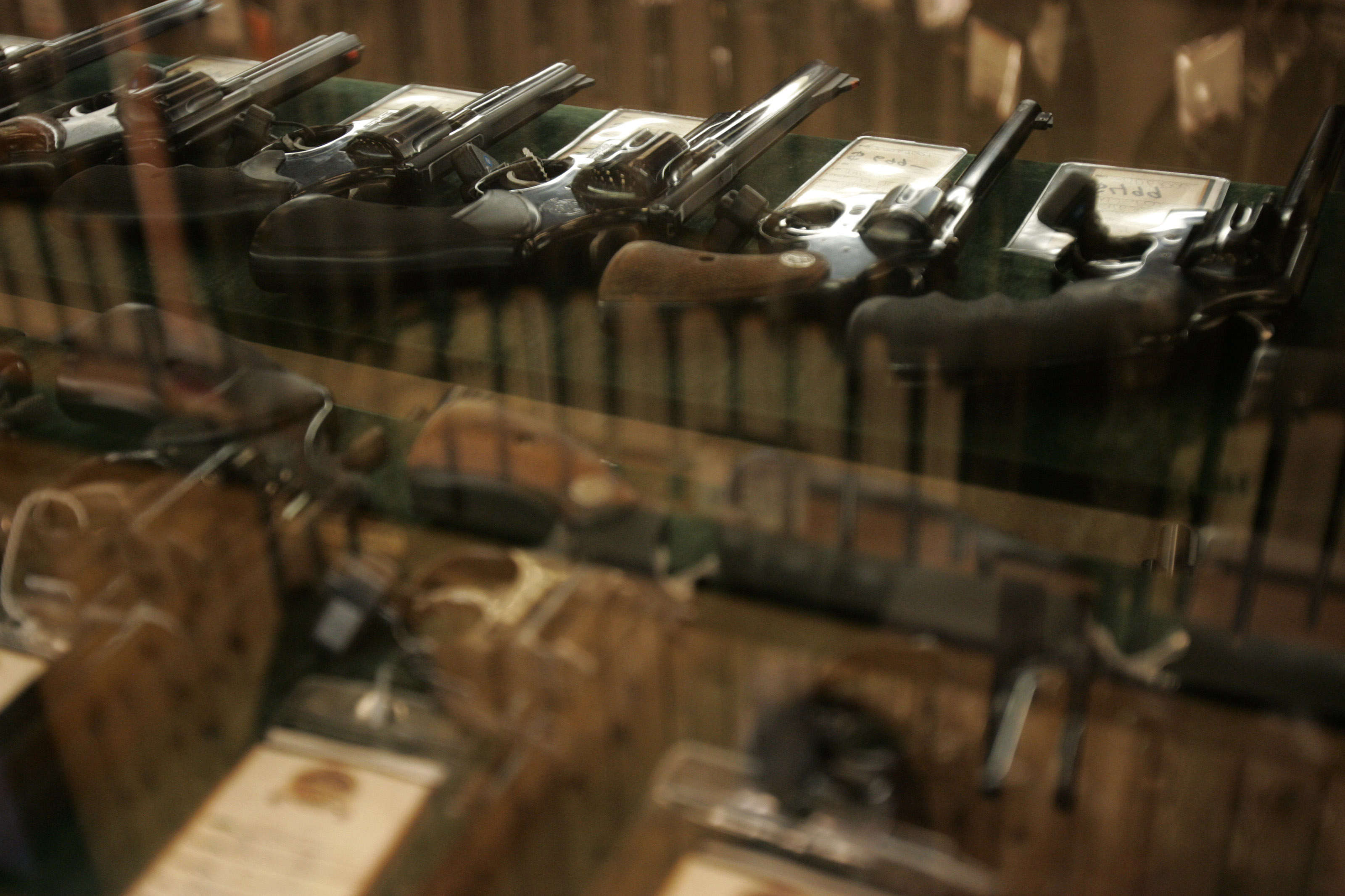 Guns on sale are stored in a case at a gun store in Fort Worth, Texas June 26, 2008. Texas is poised to legalize open carry of handguns for licensed residents. Photo by Jessica Rinaldi/Reuters