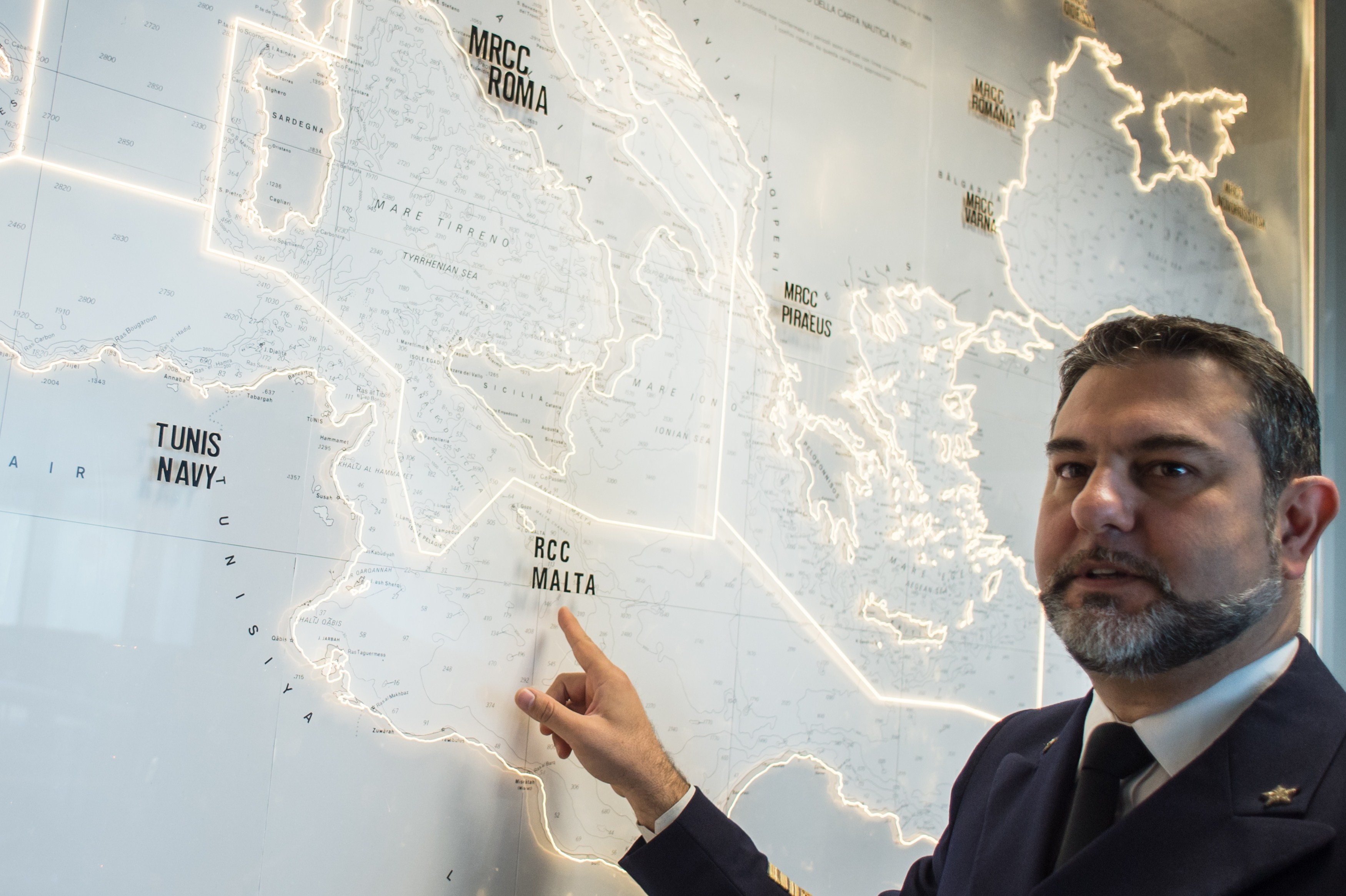 Italian officer Gianluca D'Agostino of the Italian Coast Guard, looks at a map of the Mediterranean Sea, in the control center at the headquarter of Italian Coast Guard, on May 28 2015, in Rome. Photo by Andreas Solaro/Getty Images.