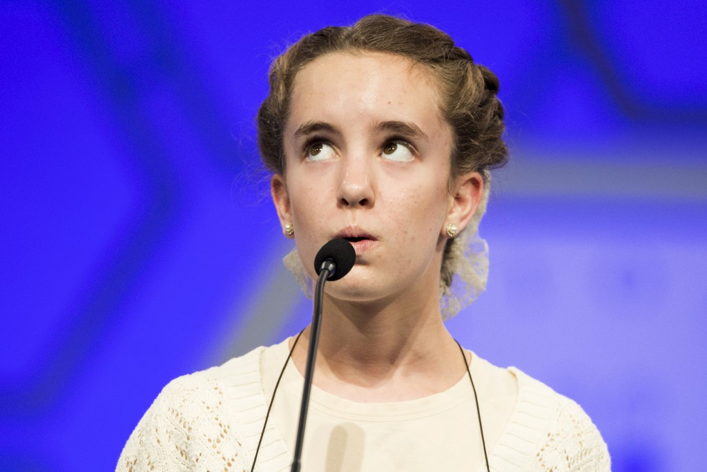 "Olivia Hajicek of Goshen, Indiana, spells the word ""chrysophyte"" during the third round of the 88th annual Scripps National Spelling Bee at National Harbor, Maryland May 27, 2015. Spellers in the 88th annual bee range in age from nine to 15 and are the cream of more than 11 million hopefuls who took part in local contests. They come from eight countries and all 50 U.S. states, the District of Columbia, U.S. territories and Defense Department schools.  Photo by Joshua Roberts/Reuters."