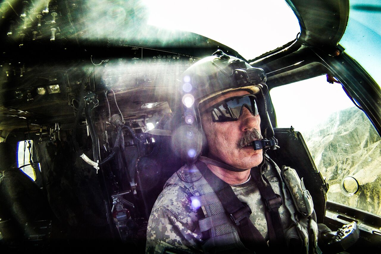 Chief Warrant Officer 4 Walt Jones, a Vietnam veteran, flies a Black Hawk helicopter over the mountains of Zabul Province in southern Afghanistan. Photo by Ben Brody/The GroundTruth Project