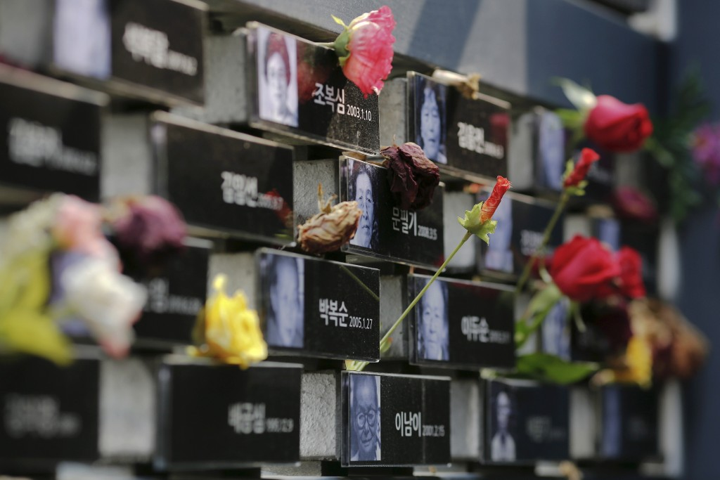 "Flowers are placed on a memorial wall commemorating the late former South and North Korean ""comfort women"" at the War and Women's Human Rights Museum"" in Seoul. South Korea and Japan reached a breakthrough settlement Monday to resolve a decades-long dispute regarding Korean women forced into sex slavery by the Japanese military during World War II. Photo by Kim Kyung-Hoon/Reuters"