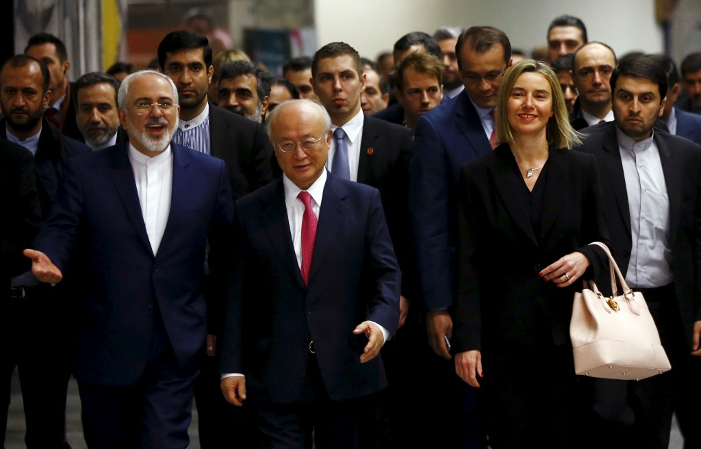 Iranian Foreign Minister Javad Zarif, International Atomic Energy Agency (IAEA) Director General Yukiya Amano and the High Representative of the European Union for Foreign Affairs and Security Policy Federica Mogherini (front L-R) arrive at the United Nations building in Vienna, Austria, Jan. 16, 2016. Republicans mostly criticized President Obama for his willingness to conducts talk with the longtime U.S. foe, but praised the release of five American prisoners. Photos By Leonhard Foeger/Reuters