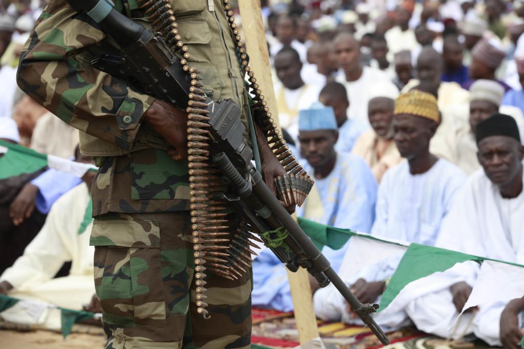 Nigerian soldiers stand guard during Eid al-Fitr celebrations in Maiduguri, Nigeria on Aug. 8, 2013.  (AP Photo/Sunday Alamba, File)
