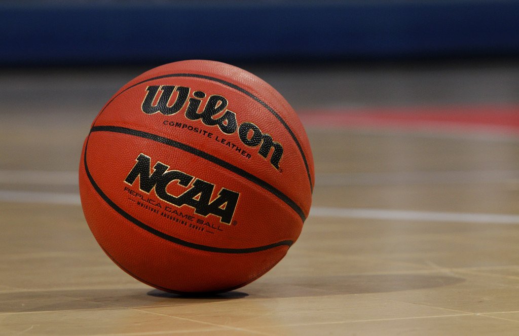 A detail view of an Wilson NCAA basketball is seen on a court at Bracket Town on Sunday April 3, 2011 in Houston, Texas.