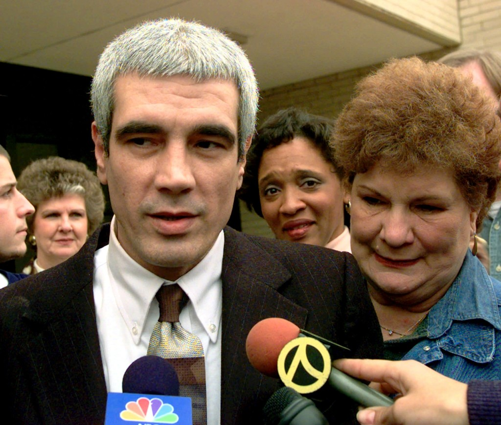 Kerry Max Cook with his mother Evelyn at his side speaks to the media after he was released from the Smith County Jail in Tyler, Texas, Tuesday Nov. 11, 1997. Cook, a former Texas death row inmate, had been jailed pending his fourth trial for capital murder.