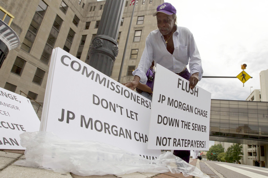Freddie Jones of Birmingham, Ala., demonstrates outside the Jefferson County Courthouse in Birmingham, Ala., Thursday, Aug. 4, 2011. Jefferson County Commissioners are struggling to find a way to avoid declaring bankruptcy.