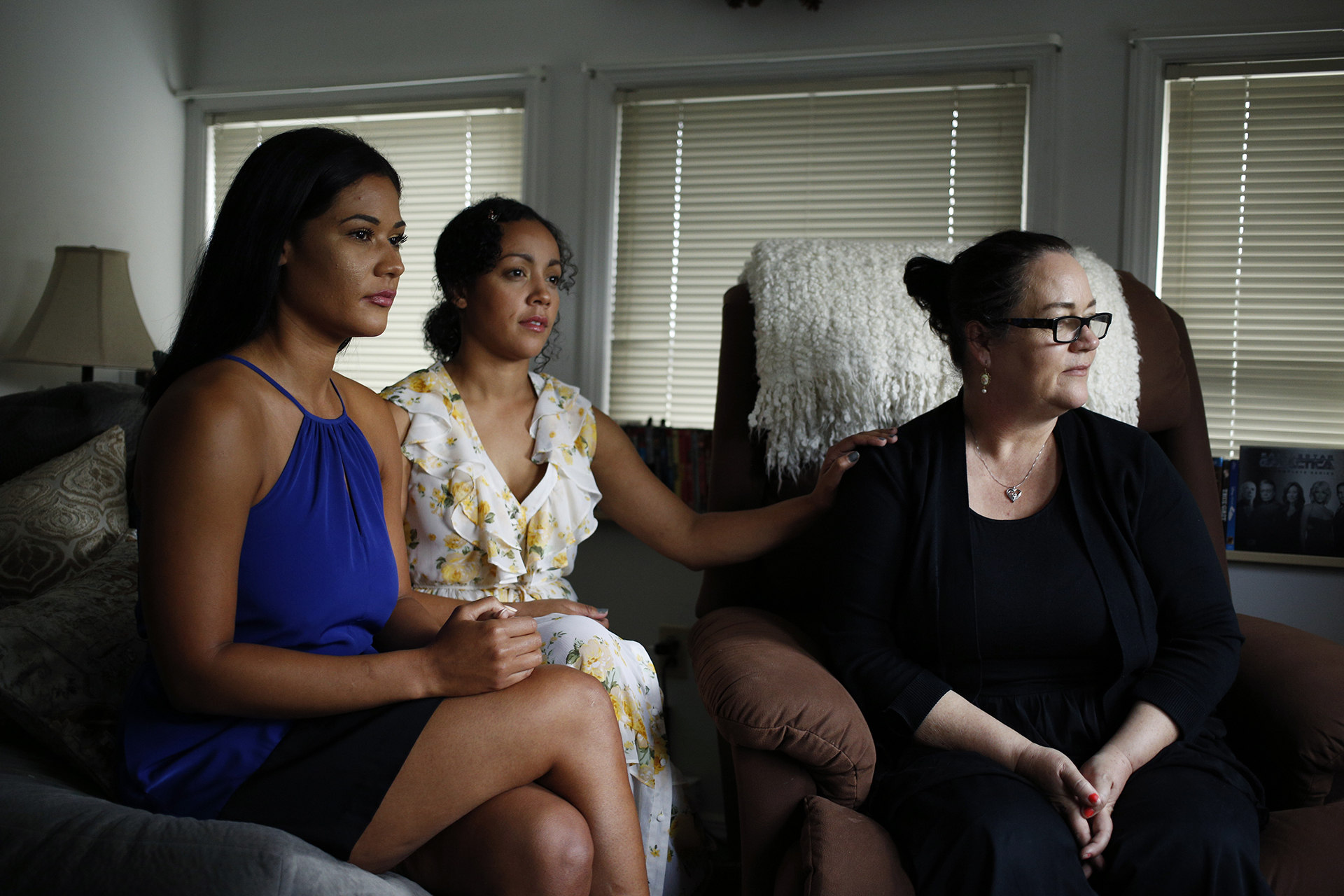 Heather Poole (left) and Natasha Ault (center) sit for a portrait with their mom Ida Poole, mother of the late R.J. Williams, on June 21, 2018 in McKees Rocks, Pa.