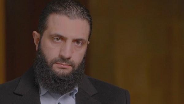 Abu Mohammad al-Jolani, leader oftheSyrian Islamist militant group Hayat Tahrir al-Sham, sits fora February 2021interview with FRONTLINE correspondent Martin Smithin Idlib province, Syria.