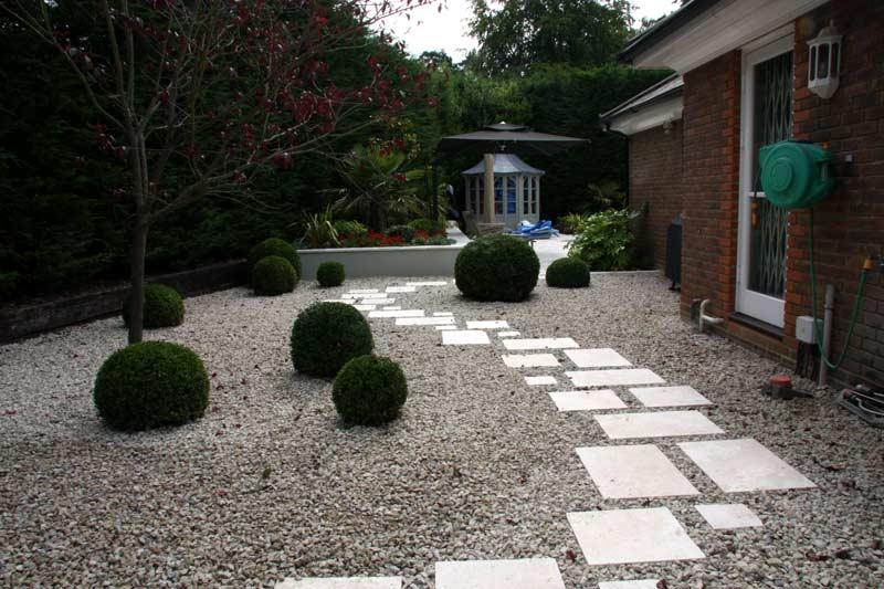 Travertine paving and gravel garden in Berkshire