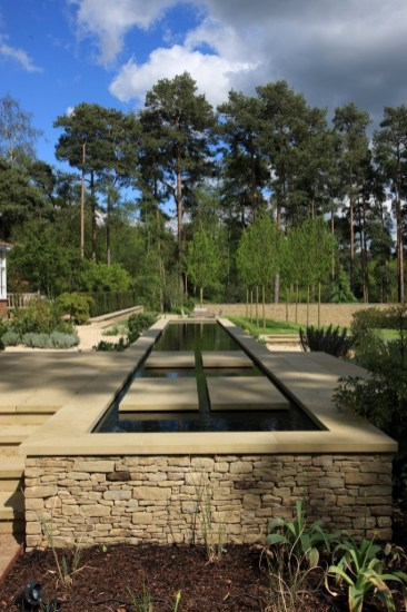 Water feature with stone walls