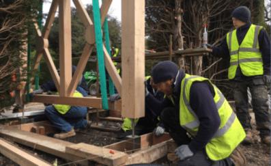 PC Landscapes team fitting the bespoke oak pergola