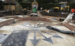 Laying the York stone and Caledonian slate paving.
