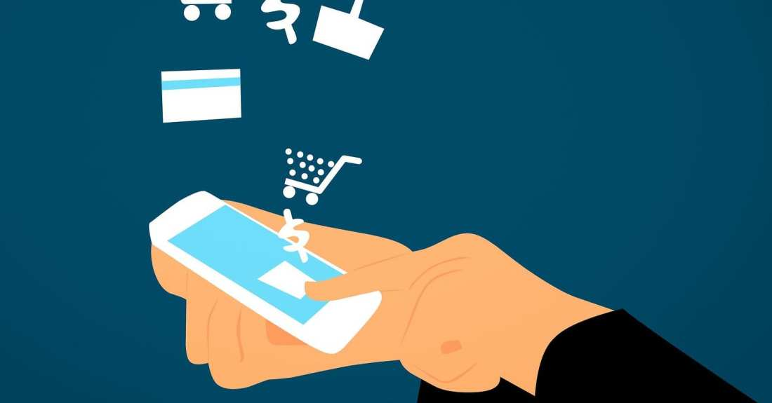 Cartoonish picture of a hand pressing buttons on a phone utilizing e-commerce symbols