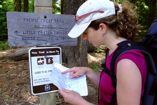 While much of the Pacific Crest Trail is signed and well-marked, it is still a good idea to carry (and know how to read) a good map and compass to keep you going in the right direction. Photo by Eli Boschetto
