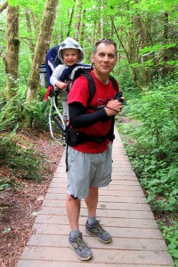 Guidebook author Craig Romano with son (and junior assistant) Giovanni on the trail on Washington's Kitsap Peninsula. Photo by Heather Romano.