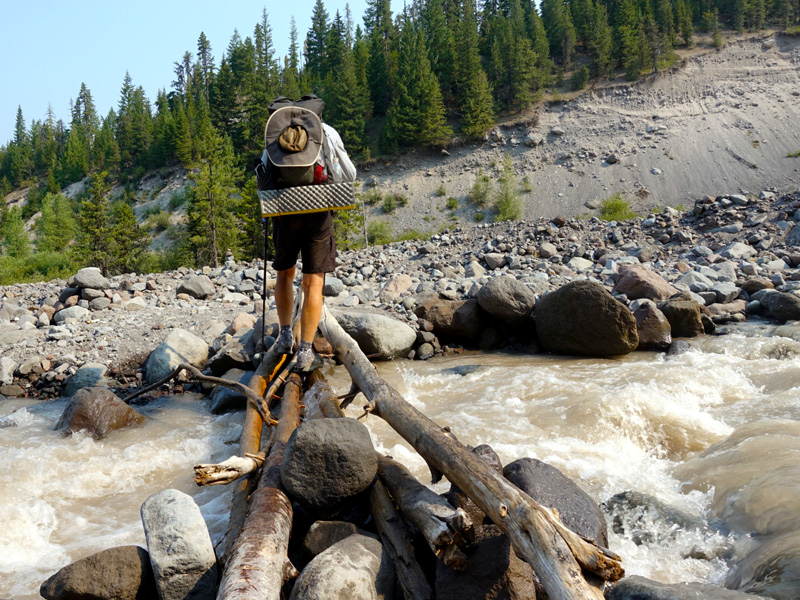 PCT hiker on the precarious Sandy River crossing. Photo by Tami Asars.