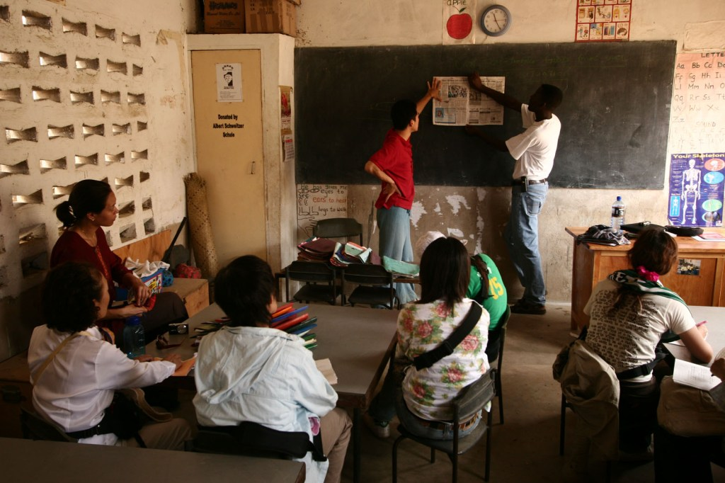Participants visit a primary school on the outskirts of Mombassa, Kenya
