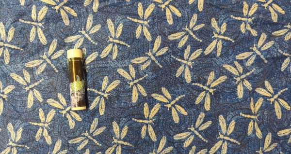 fabric with yellow dragonflies on a dark blue background
