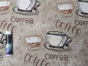 fabric with coffee cups and text