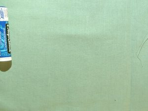 pea green solid-colored fabric