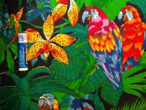 fabric with tropical foliage, parrots, and yellow flowers